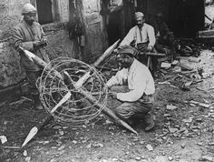 A man building barbed wire defences on the Somme, WW1