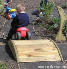 Roadway bridge – easy addition to a trike path. This site has some other cool wooden designs for playgrounds