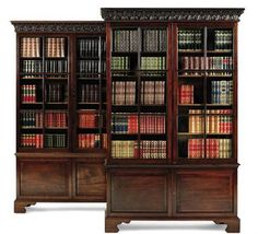 A PAIR OF GEORGE II STYLE MAHOGANY BOOKCASES