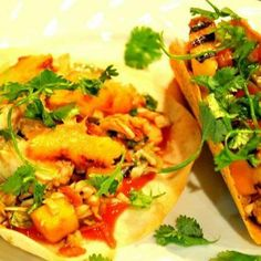 ... ....Grilled Chicken and Pineapple Tacos with Cabbage and Mango Slaw
