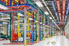 Caption:These pipes send and receive water for cooling Google's data center in Douglas County, Ga. Workers use the bike shown in the photo to get around the vast data center. Credit: Google