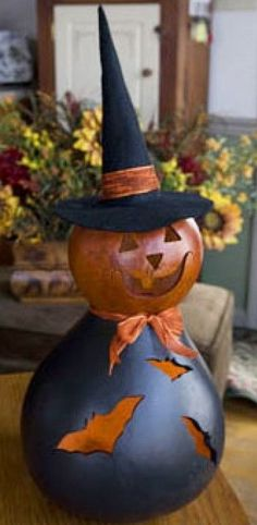These witches are black and burnt orange in color. The Large Lit is approximately 8 inches in diameter. Comes with an electric light. More Más Halloween Gourds, Halloween Projects, Holidays Halloween, Halloween Fun, Halloween Decorations, Hand Painted Gourds, Painted Pumpkins, Fall Crafts, Holiday Crafts