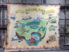 Peter Pan Neverland Map for stage production.  Measures 12 feet high by 16 feet wide.  Painted on flame retardant muslim with Rosco paint.  Burnt edges were backed by black tule to support them.  Used be Fantasy Playhouse Children's Theatre in Huntsville Alabama.
