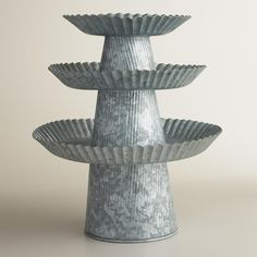 Available in three sizes, our exclusive, handcrafted cake stand is an attractive centerpiece alone, stacked or grouped in multiples. >> #WorldMarket Easter