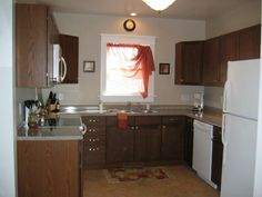 1b  Blue Kitchen, Wreck no more!  Perfect work triangle, lots of counter surface and beautiful!  Remodeled, Staged, Accepted offer in 22 days!