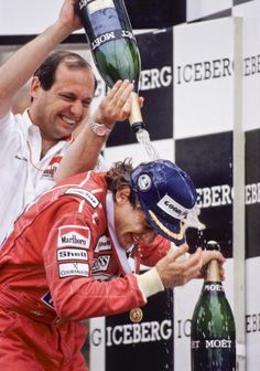 Ayrton Senna of Brazil and the MclarenHonda team is doused with champagne by a teammate after winning the Formula One United States Grand Prix held...