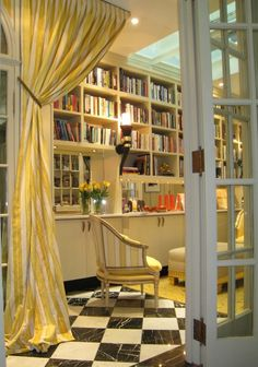 Classic home library in cheery yellow.