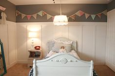 Love the pennants above the board and batten.. in need to do that in the girls' room