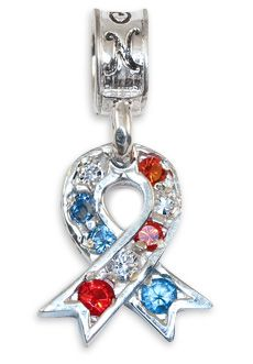Nomades - Patriotic Ribbon - Our Patriotic Ribbon charm is sterling silver with a channel of 9 gems; 3 red, 3 clear, and 3 blue.