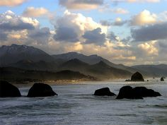 We drove along the coast of Oregon down to California. The coastline is just beautiful.Cannon Beach was one of my favorite stops. Cannon Beach Oregon, Oregon Road Trip, Seaside Style, Seascape Art, Cascade Mountains, Oregon Coast, Weekend Trips, Solitude, Nature Pictures