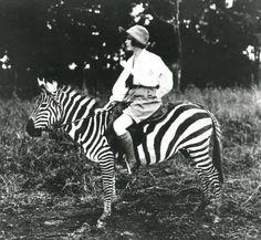 Osa Johnson riding a zebra