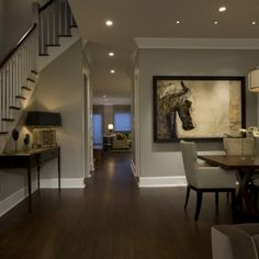 Art, lighting, wood floors, baseboards- done right