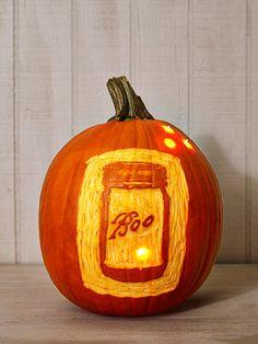 """This ode to the iconic Ball Mason jar features """"fireflies"""" courtesy of string lights. Mason Jar Pumpkin, Pumpkin Ideas, Pumpkin Designs, Spooky Pumpkin, Pumpkin Art, Pumpkin Faces, Halloween Party Decor, Halloween Pumpkins, Holidays Halloween"""