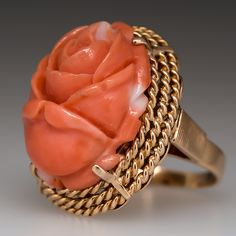 Jewelry OFF! This vintage coral ring is centered with s lovely coral carved rose. The Rose is a beautiful peach color and is surrounded by 3 twisted wire bezels the ring is crafted in solid yellow gold and is in very good condition. Coral Ring, Coral And Gold, Coral Jewelry, Bridal Jewelry, Gold Ring, Silver Jewelry, Le Jade, Antique Jewelry, Vintage Jewelry