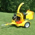 "PowerTek (7"") 25HP Hydro-Feed Tow-Behind Chipper Shredder. Slash left from clearing or logging-off gets turned into profitable mulch with very little effort on your part. Just get the material up to the chute; the hydraulic feed takes it into the heavy-duty flywheel & reversible knives so you're freed up to get the next batch ready.    The 360° rotating discharge chute is a nice touch, too. It allows you to feed the chips into a cart or truck; or create a tidy pile."