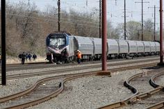 Accident investigators will interview survivors of a construction crew on Tuesday to determine why a backhoe occupied the same track as an Amtrak train that slammed into the heavy equipment, killing two people and sending 35 others to hospital.  Sunday's accident in the Philadelphia suburb of Chester