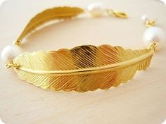 there is something so elegant and natural about feather jewelry