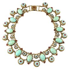 Hungarian Turquoise Necklace  Hungary - 1940's.   Unsigned Hungarian necklace. Turquoise stones and enamel turquoise flowers with red stones.
