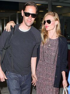 Here comes the newlyweds! Hubby 'n' wife Michael Polish, in flat-top sunnies, and Kate Bosworth, in aviators, were glowing as they arrived in Los Angeles after their intimate Montana wedding!