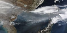 A thick band of haze blew over the Sea of Japan during April, appearing as a translucent band of dingy gray