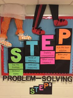 motivational bulletin board using arrows and large letter