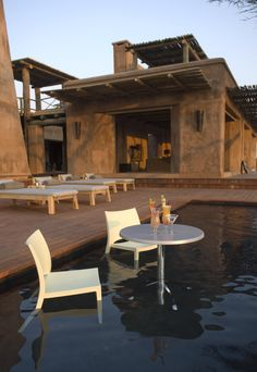 If you are looking for a romantic getaway in the desert this is the place for you. The Onguma The Fort in the Etosha National Park Namibia. There is one honeymoon Suite where the sunsets are spectacular. Land Of The Brave, Red Houses, Honeymoon Suite, Vernacular Architecture, Best Sunset, Floating House, Stone Houses, Tasting Room, Lodges
