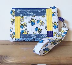 Minions wristlet purse, zippered wallet pouch, patchwork quilted by PopThree on Etsy https://www.etsy.com/listing/255811916/minions-wristlet-purse-zippered-wallet