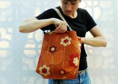 Vibrant retro-mod floral handbag made with stain-resistant NanoTex commercial upholstery remnants from Architex Textiles. Handmade by textilecouture, $79.00