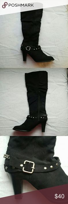 """Faux Suede Heeled Boots Faux Suede black heeled boots. Has a strap around ankle. Strap has silver buckle and silver studs. Also has a silver chain on back of boot. 3"""" inch heel. Worn a few times. Unisa Shoes Heeled Boots"""