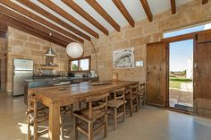 Large dinning room for those who love to have company.  #dinningroom #woodtable #fincaforsale #pollentiaproperties #majorca #fincamajorca