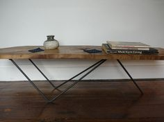Cool coffee table made out of old found bits BUT notice the 'Whole Earth Catalogue' on it.