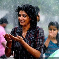 A young lady enjoys first day of monsoon rain in Delhi, What a lovely smile !