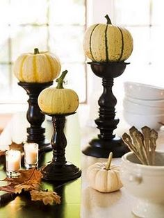 Mini pumpkin on candlesticks