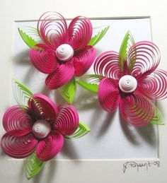 Love this kind of paper art. These would make a cute magnet I think. #flowers #crafts