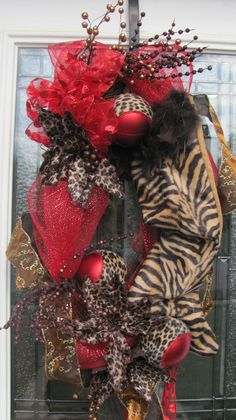 Animal print Christmas wreath by JustforYouOwensboro on Etsy, $75.00