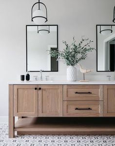Chic and elegant, the Somerset collection exudes a quiet and precise sophistication.   Subtly fusing modernity with vintage appeal, its etched opal glass deftly floats inside a streamlined metal yoke and ring while understated turned metal knobs add an authentic edge.   ​@mhousedevelopment ​📸 by @margaretrajic ​  #pendantlighting #bathandvanitydesign #geometricflooring #hinkleystyle