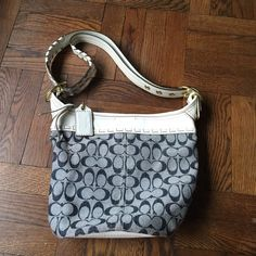 """Coach handbag Perfect for spring and summer. Brand new and never worn! White leather with denim fabric C.approx 10.75"""" L x 13"""" W. Adjustable strap! Comes with dust bag! Coach Bags Hobos"""