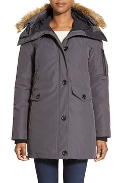 Free shipping and returns on Vince Camuto FauxFur Trim Parka at Nordstrom.com. Fluffy faux-fur trim adds wintry appeal to a rugged, insulated parka with a multitude of pockets for utility and inset storm cuffs for extra warmth. Detach the ruff for a more understated look.<br>