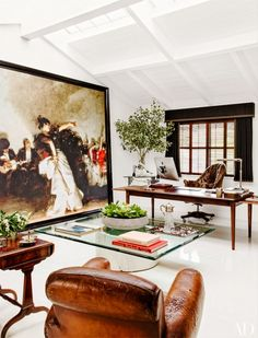 White works with glass table. Huge canvas art.  16 Envy-Inducing Celebrity Art Collectors via @domainehome