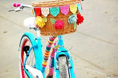 This colorful bike makes me smile. Crochet bunting and roses, snugly wrapped...beautiful.  Greedy For Colour: Beach Biking.