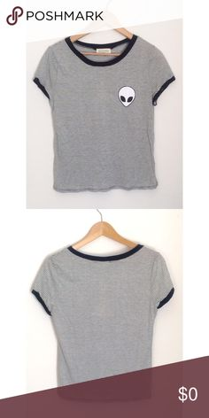 NWTStriped Tee Size L but fits Small/Medium NOT BRANDY MELVILLE. listed for exposure. New with tag. Fits a medium or small even though it's large. Accepting offers. DO NOT COMMENT ON MY LISTINGS STATING YOU SAW IT CHEAPER SOMEWHERE else. Brandy Melville Tops Tees - Short Sleeve