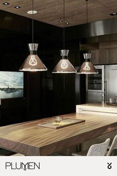 Beautiful and minimal kitchen lighting idea. Install pendant lighting, such as the Plumen Designer LED Light Bulbs, above a kitchen counter or kitchen island to create the perfect lighting atmosphere. Metal Lamp Shade, Plumen Light, Modern Led Lighting, Kitchen Lighting Fixtures, Kitchen Lighting Design, Lighting Inspiration, Lighting, Best Kitchen Lighting, Minimal Kitchen