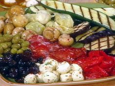 Antipasti Platter _ Marinated or plain bocconcini (small mozzarella balls), grilled eggplant and zucchini, sundried tomatoes, Marinated Roasted Red Peppers, Marinated artichoke hearts, Marinated mushrooms, green and black olives, and Soppressata (hard Italian sausage).