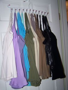 Another Cami organization-Closet Space Saving Tip now I hang my Cami's on a belt holder.