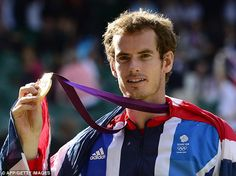 Flying the flag: Murray, draped in the Union Jack, proudly shows off his Olympic gold medal