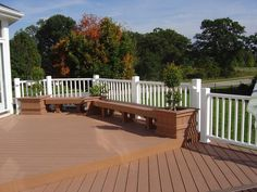 Deck with Level Change and Built in Benches with Planters by Archadeck