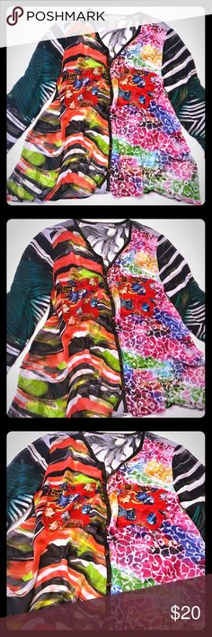 Colorful Multi-Print Mesmerize Blouse This is a stunning flowy button-down top with lots of vibrant colors. It has a sheer texture so it will need to be worn with a cami underneath. There are two front pockets and sleeves can be rolled up slightly. It's very lightweight and airy. It's in excellent condition and signs of wear that I noticed! Mesmerize Tops