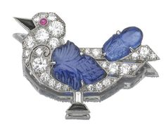 An art deco ruby, sapphire and diamond bird brooch by Caldwell & Co.