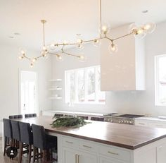 White kitchen high ceilings statement light fixture