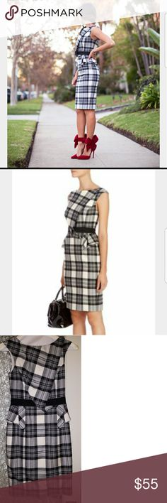 Karen Millen Plaid wool dress Fitted wool dress. Looks cute layered or alone. Only worn one time. Beautifully made. High quality craftsmanship. You will love this dress for fall and winter. Runs very small. Says size 4 us. But it's really a two. Karen Millen Dresses